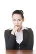 Sad businesswoman sitting behind the desk