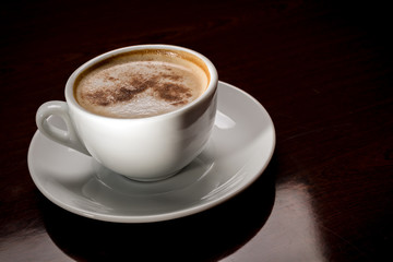 White cup of freshly brewed coffee in cafeteria