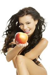 Happy fit nude woman with apple