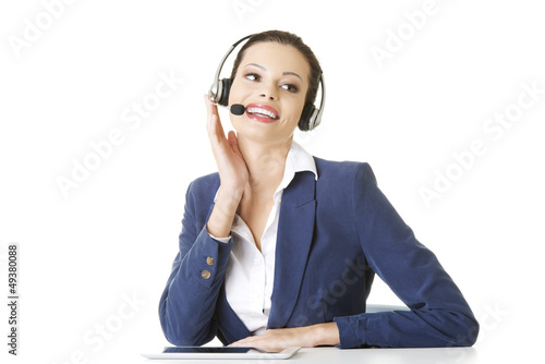 Beautiful young call-center assistant at the desk