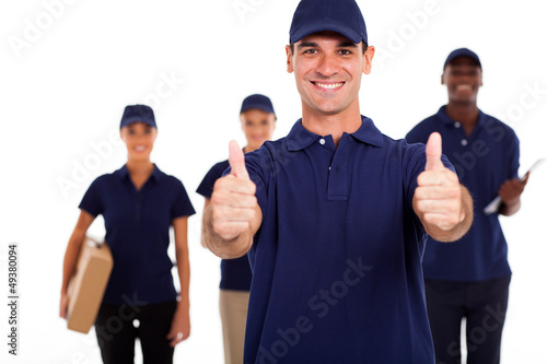 IT technician giving two thumbs up in front of colleagues