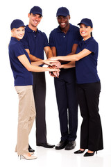 group of service industry staff hands together