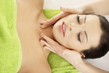 Face massage therapy at spa saloon