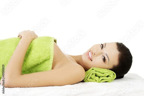 Beauty young woman relaxing in spa.