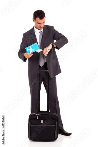 smart business traveller checking flight time