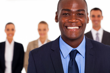 african american businessman in front of group colleagues