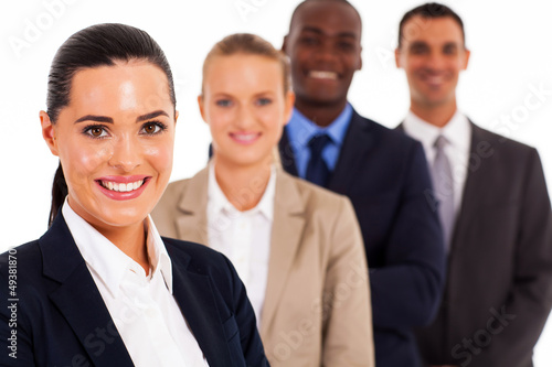pretty female corporate worker and team on white