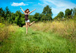 Woman jumping on nature walkway