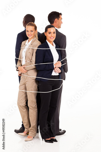 group of business people tied up together