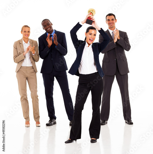 business team applauding when businesswoman winning a trophy