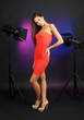 Beautiful young woman in dress pose in photo-studio