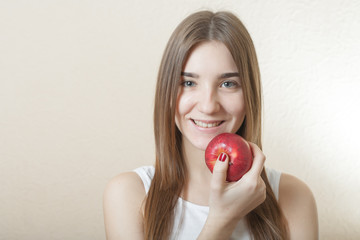 Beautiful blonde woman holding a red apple