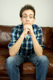 Young man sitting on couch