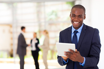 happy african american businessman with tablet computer