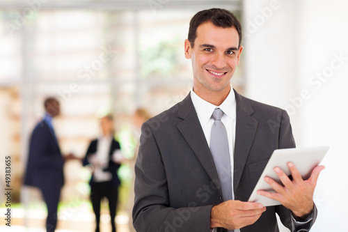 handsome businessman with tablet computer in office