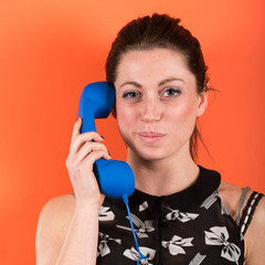 Smiling Young Woman with Phone Receiver