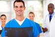 handsome medical doctor and team in hospital