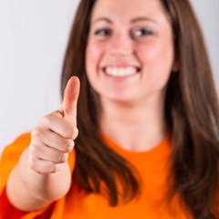 Joyful Young Woman with Thumb Up
