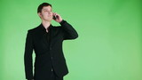 cheerful young businessman talking on phone and smiling