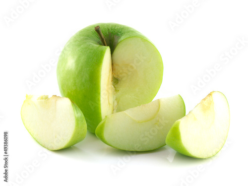 Isolated sliced green apple with three slices.