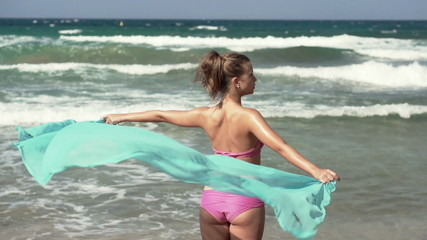 Sexy woman with pareo on beach, super slow motion