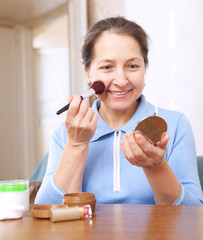 woman putting facepowder on  face