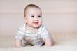 cute baby boy crawling indoors