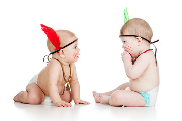 Two funny little children indians. Isolated on white background