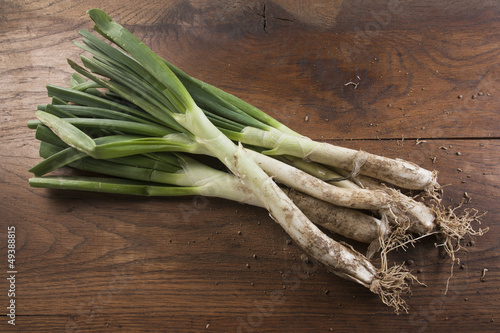 Bunch of calçots on wooden table