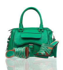 Green summer shoes and handbag over white