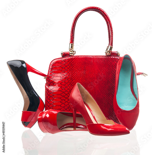Red fashion women shoes and handbag over white