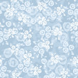 Seamless pattern with roses on a blue background. Vector.