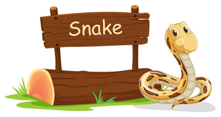 A snake beside a signboard