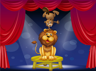 A lion and a beaver performing on the stage