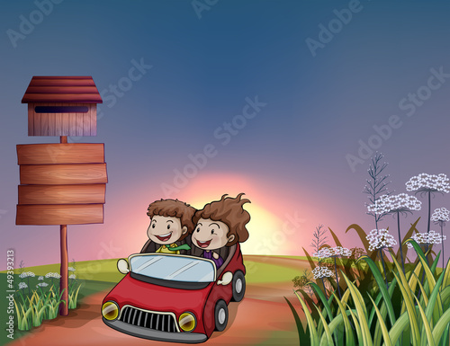 Kids in a car, notice board and a letter box