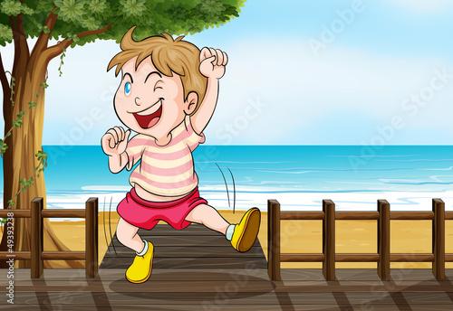 A boy dancing on a wooden platform