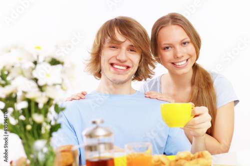Couple at home drinking tea