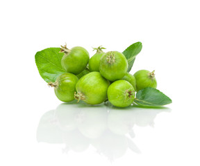 green apples and leaves on a white background