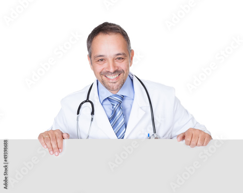 Portrait Of A Doctor Holding Blank Placard