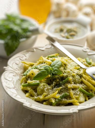 pesto trofie typical genoa recipe, selective focus