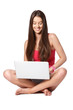 happy teenager with laptop sitting on white background