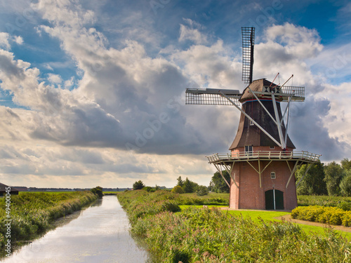 Dutch Windmill besides a Canal
