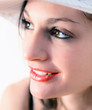 Portrait of charming smiling woman with white hat