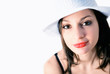 Portrait of pretty smiling woman with white hat