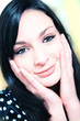 Closeup portrait of pretty cheerful young woman with hands again