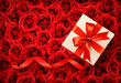 Holiday background with gift box on background of flowers.