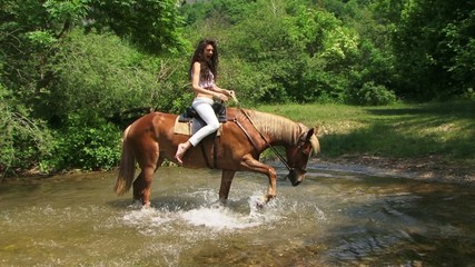 Woman ahorse posing in a river