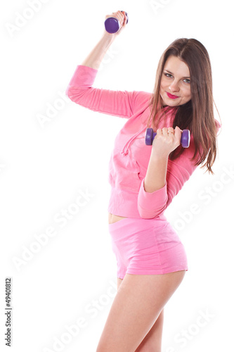 girl is engaged in fitness with dumbbells