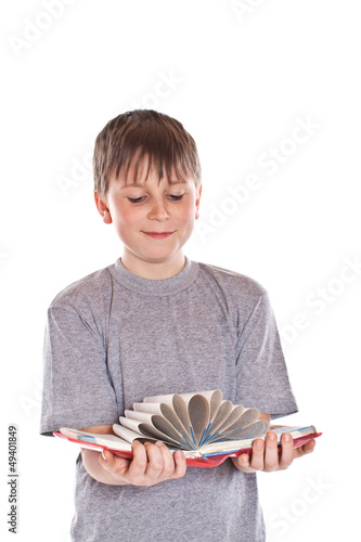 boy looks at the book