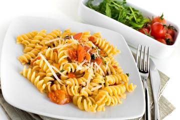 Fusilli with tomatoes and arugula
